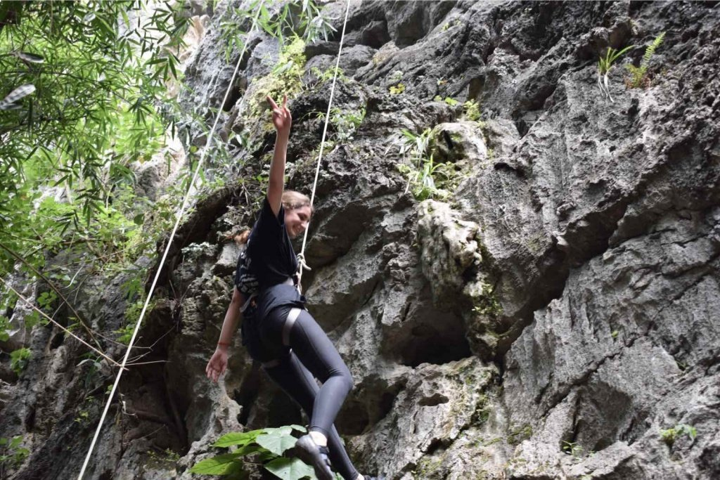 A-girl-rock-climbing-in-Yangshuo-for-the-first-time