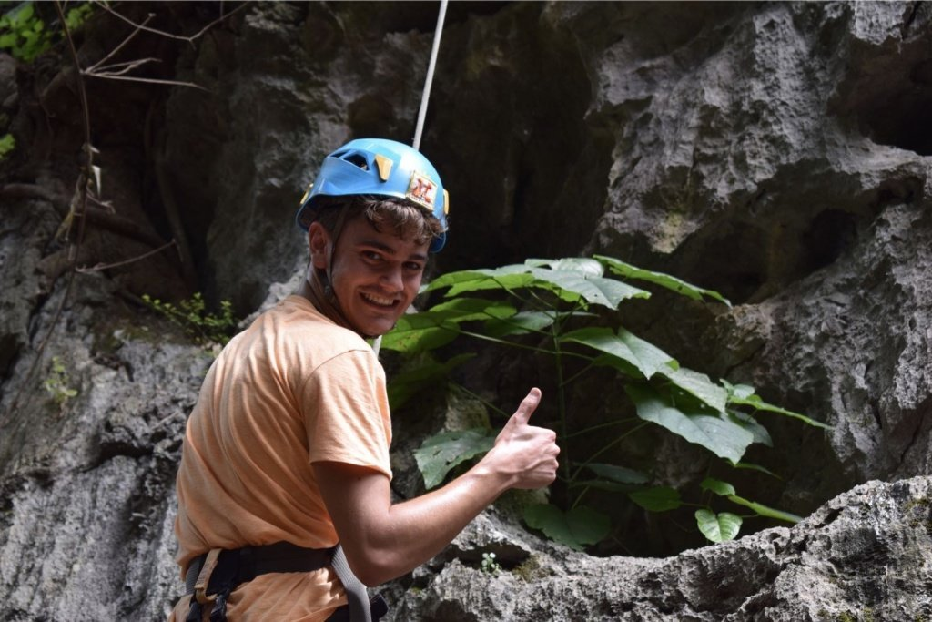 A-climber-gives-a-thumbs-up-from-the-wall